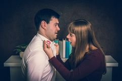 Wife finded red lipstick on shirt collar - infidelity concept. Wife finded red lipstick on shirt collar of her unfaithful husband - infidelity concept - retro Stock Image