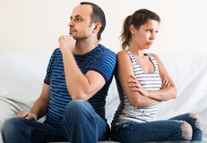 Wife and furious husband discussing divorce. Sad european wife and furious husband discussing divorce Stock Photography