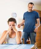 Wife and furious husband discussing divorce Stock Photos