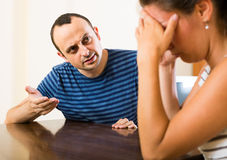 Wife and furious husband discussing divorce. Unhappy european wife and furious husband discussing divorce Stock Photo