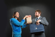 Wife giving pack with snack to her husband Royalty Free Stock Photos