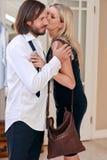 Wife goodbye kiss Stock Image