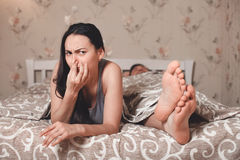 Wife has closed a nose from an unpleasant smell. Stock Photo