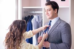 The wife helping husband to get dressed up. Wife helping husband to get dressed up Stock Photography