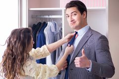 The wife helping husband to get dressed up. Wife helping husband to get dressed up Royalty Free Stock Photo