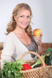Wife holding apple. Royalty Free Stock Images