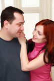 Wife hugging her husband in house Royalty Free Stock Photography