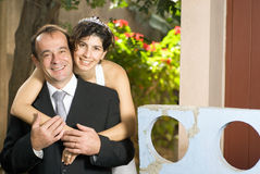 Wife Hugging Husband - horizontal Royalty Free Stock Image