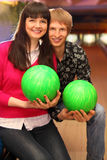 Wife and husband with balls sit in bowling club Stock Photography
