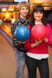Wife and husband with balls stand in bowling club Stock Photo