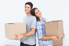 Wife and husband carrying boxes in their new house Stock Photo