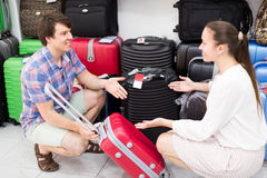 Wife and husband choosing suitcase Stock Images