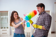 The wife and husband doing cleaning at home Stock Photography