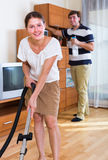 Wife with husband doing  regular clean-up Royalty Free Stock Photo