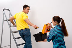 The wife and husband family doing home improvements Stock Image