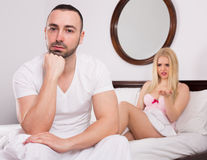 Wife and husband having difficulties in bed Royalty Free Stock Photos