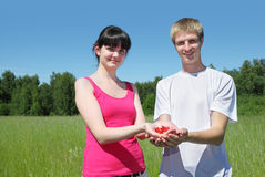 Wife, husband hold berry in hands Royalty Free Stock Photography