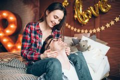 Wife and husband hugs on the bed in bedroom Stock Photography