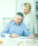 Wife and husband are lead discussion. About agreement of the credit stock images