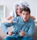 Wife and husband looking at pregnancy test stock images