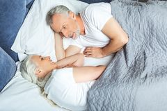 Wife and husband lying in the bed stock images