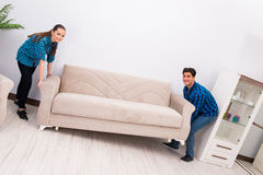 The wife and husband moving sofa couch Stock Photography