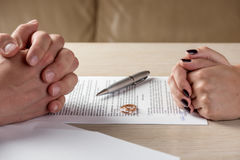 Wife and husband signing divorce documents or premarital agreement Stock Image