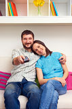 Wife with husband watching TV Stock Image
