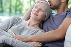 Wife and husband spending time. Young sick wife and husband resting and spending time together Royalty Free Stock Image