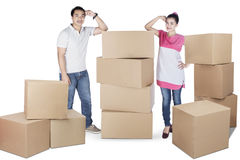 Wife and husband standing besides box Stock Image
