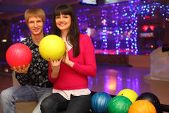 Wife and husband wit balls sit in bowling club Stock Photos