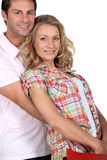 Wife in husbands arms. With bags Stock Image