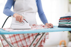 Wife ironing shirt Royalty Free Stock Photography