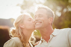 Wife kissing husband on the cheek Royalty Free Stock Photography