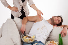 Wife and lazy husband Stock Photos