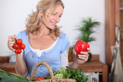Free Wife Looking At Pepper Stock Photo - 29642240