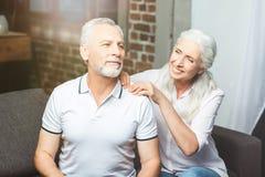 Wife making shoulder massage for husband stock image