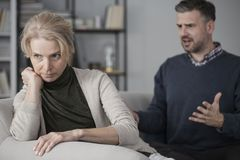 Wife and nervous husband. Wife refusing to listen to her nervous, screaming husband and giving him the silent treatment Stock Images