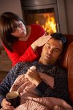 Wife Nursing Sick Husband With Cold Royalty Free Stock Images