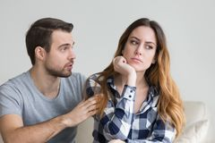 Wife offended by husband, man asks forgiveness royalty free stock photography