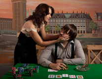 Wife persuades her husband to stop playing poker. Royalty Free Stock Image