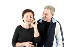 Wife on the Phone while Husband Waiting Royalty Free Stock Photography