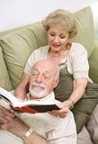 Wife Reading to Husband Stock Photo