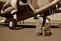 Wife saying good bye to pilot husband Stock Photo