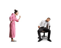Wife screaming at tired husband Stock Photography