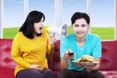 Wife shouting at her husband at home Stock Image