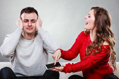 Wife shouting at husband. Cheating man. Betrayal. Royalty Free Stock Photography