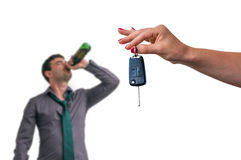 Wife showing car keys and her husband drinking alcohol Stock Photos