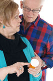Wife showing husband his pills. Stock Photos