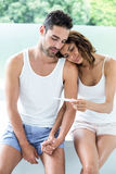 Wife showing pregnancy test to husband Royalty Free Stock Images